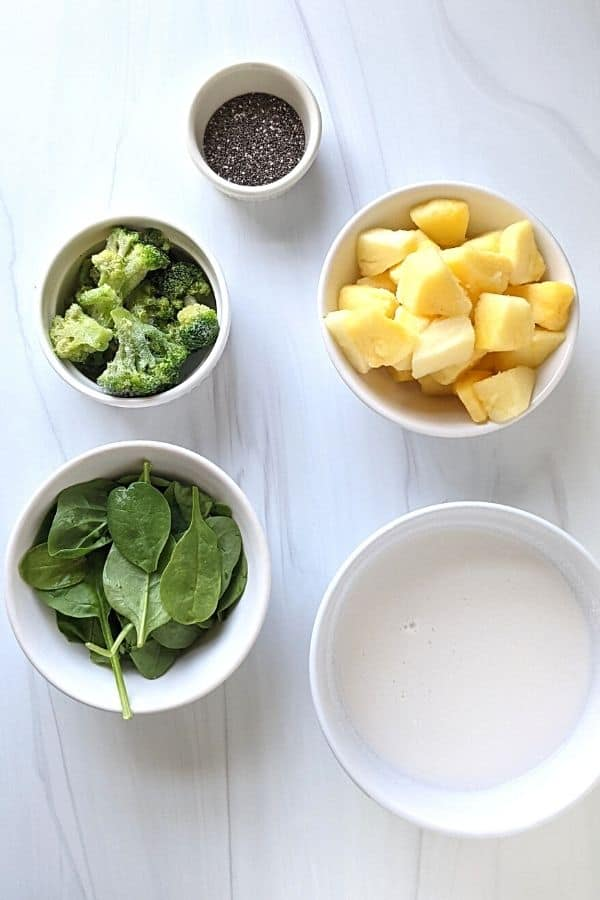 easy ingredients of the broccoli smoothie with pineapple, chia seeds, broccoli, spinach, and coconut milk