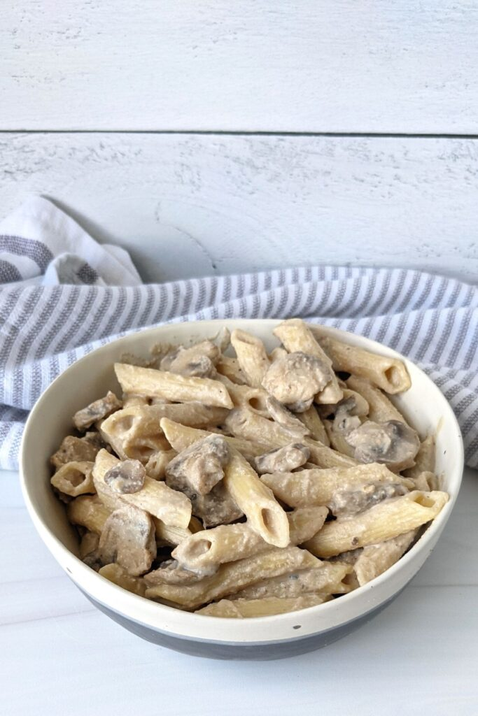 Easy vegan mushroom stroganoff done in 20 minutes, oil free, and high in protein. For 660 calories you get over 30 g plant based protein!