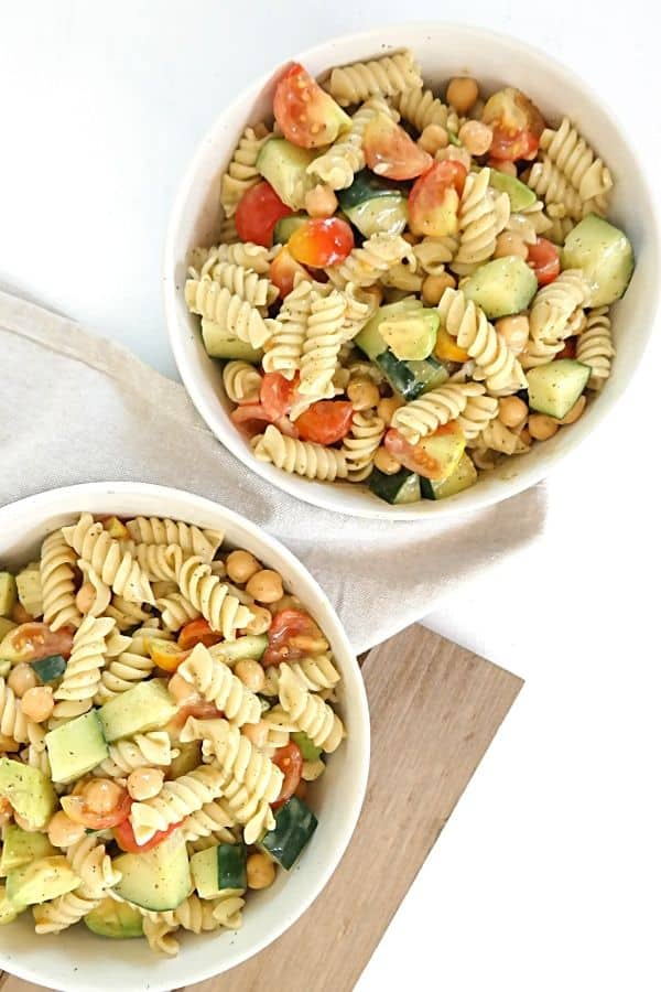 two bowls of plant based pasta salad with oil free dressing